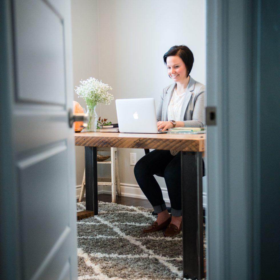 Andrea Parker working at desk