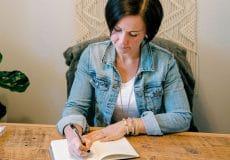 Andrea parker writing at desk