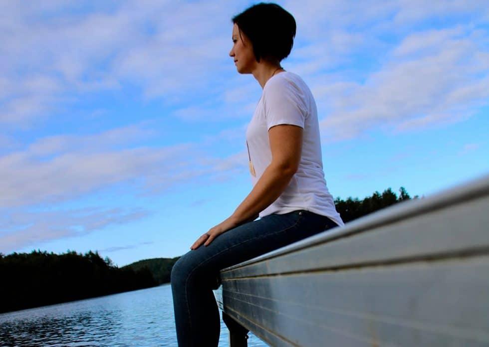 andrea parker sitting on dock at sunset