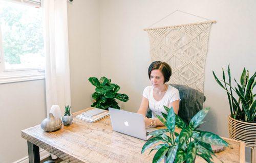 Andrea Parker at desk