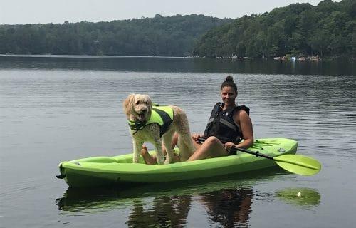 Mel Mills on Kayak with Dog